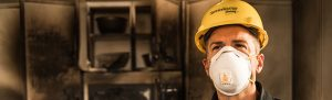 servicemaster technician waring face mask after fire