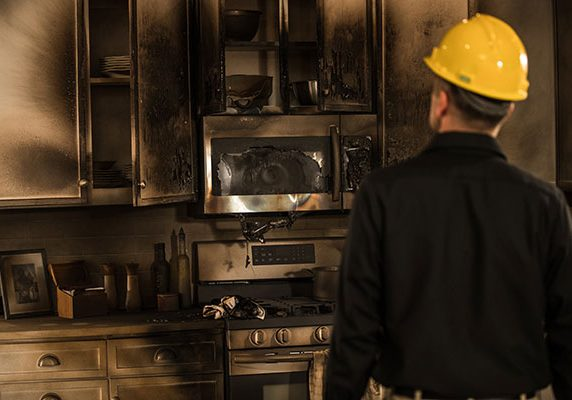 man facing damage from a kitchen fire